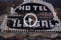 GREENPEACE ACTIVISTS PAINT THE 'ILEGAL HOTEL'