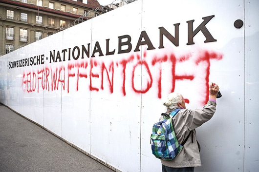 86-YEAR-OLD WOMAN SPRAYPAINTS ON SWISS NATIONAL BANK