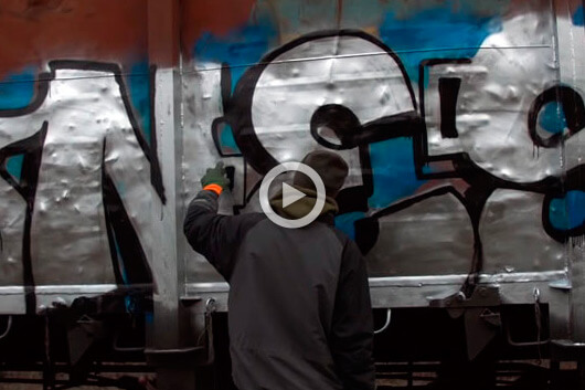 NESK PAINTING A FREIGHT TRAIN